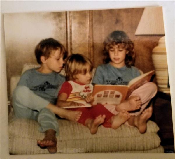Reading to my younger siblings, circa 1983
